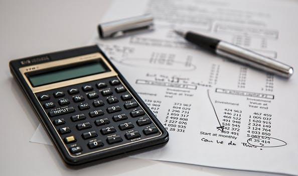 Calculator, pen, worksheet